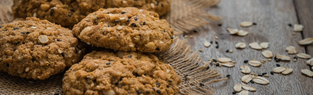 Oatmeal cookies with sesame seeds on sackcloth